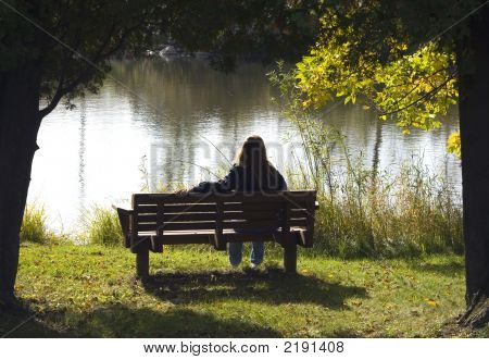 Lonely Girl On A Park Bench