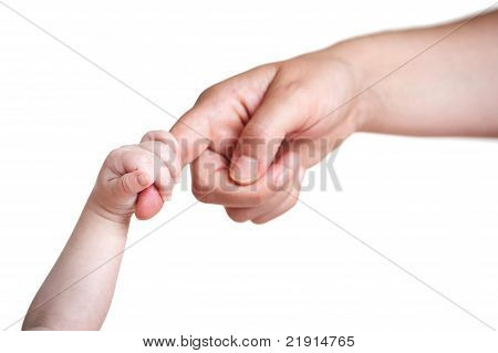 baby's hand holding finger of mother