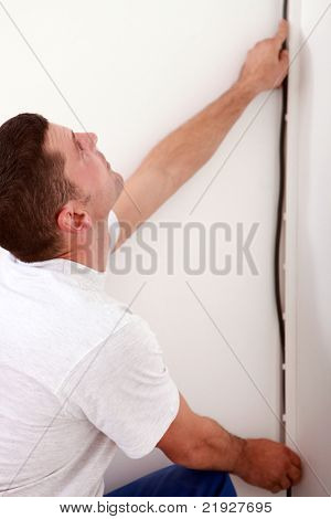 electrician installing cable