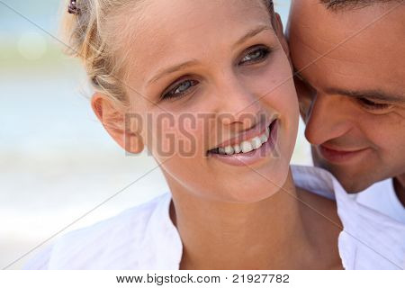 Man nuzzling his wife's neck