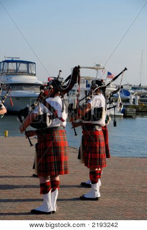 Bagpipers On The Shore