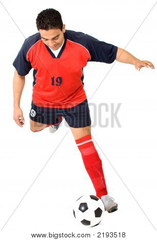 Footballer About To Kick The Ball