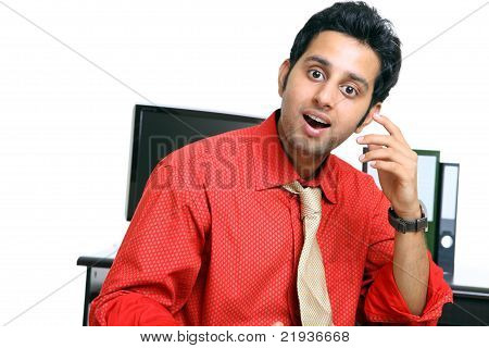 Surprised Indian young businessman in office