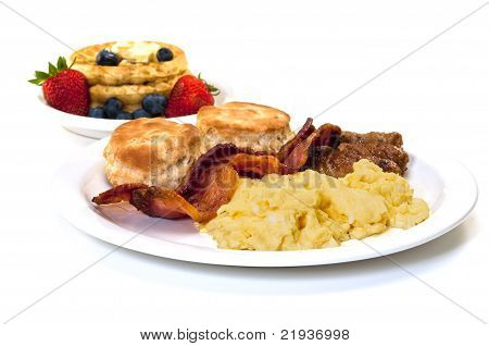 Breakfast With Eggs, Bacon , Sausage, Biscuits  And Waffles