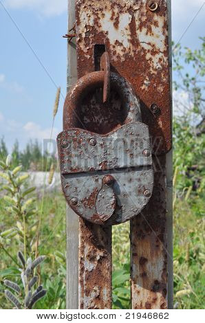 Padlock on an broken gate