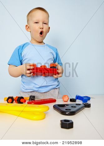 Little Kid Playing With Plastic Toys