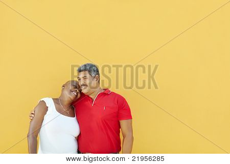 Happy 50 Years Old Man Embracing Woman
