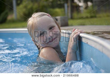 Girl Smilimg In Pool
