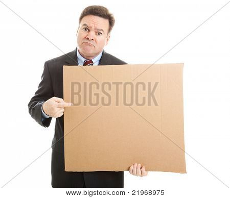 Desperate, unemployed businessman holding up a message on a cardboard box.  Blank for your text.