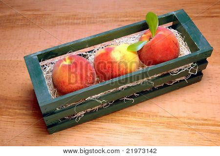 Three Peaches in Crate