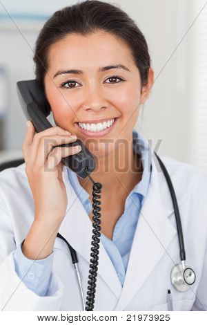 Pretty Female Doctor On The Phone And Posing