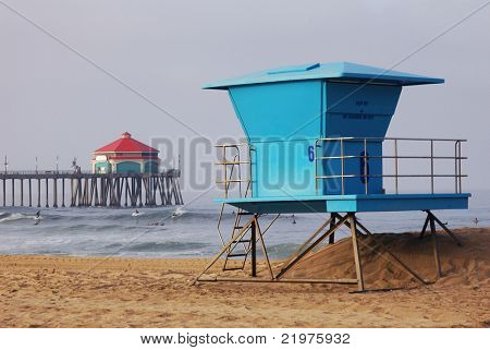 Lifeguard Tower with pier and surfers in distance, Huntington Beach, CA