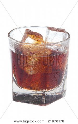 Glass of Cola with ice cubes and condensation isolated over white background