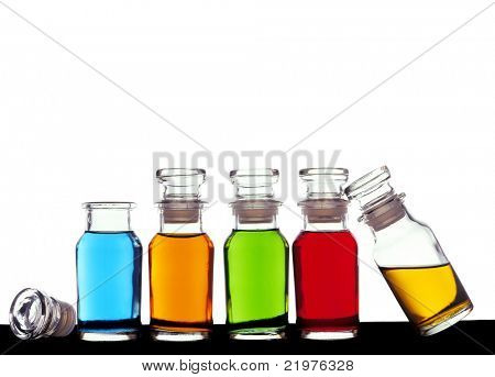 Bottles with essential oils isolated on white background