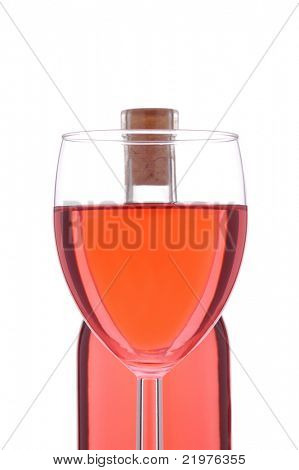 Blush or Rose Wine Glass in front of wine bottle isolated