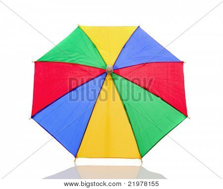 Multi-colored umbrella isolated on white background with reflection. Shows top side of object.