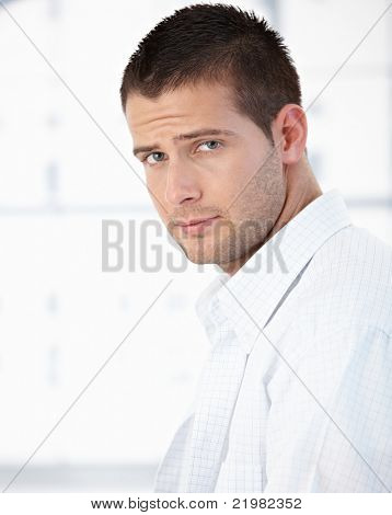 Portrait of handsome young man in shirt in the morning.