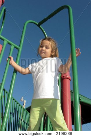 Little Girl On Playground Equipment