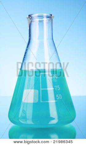 Conical flask on blue background