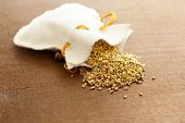 stock photo of gold nugget  - gold nuggets spilling out from a small pouch - JPG