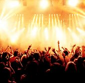 stock photo of pop star  - silhouettes of concert crowd in front of bright stage lights - JPG