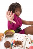 stock photo of bulimic  - Pretty black girl holding her hand out to hide - JPG