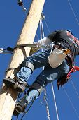 image of lineman  - an electrical lineman working on a line - JPG