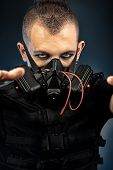 image of skinhead  - Shot of a conceptual man in a respirator - JPG