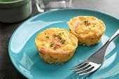 Plate with tasty egg muffins, closeup poster