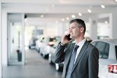 Businessman At The Car Showroom poster