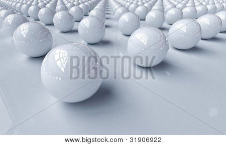 White balls on a light background with reflections