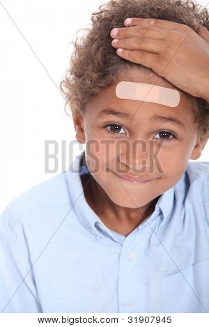 Little boy with plaster on head