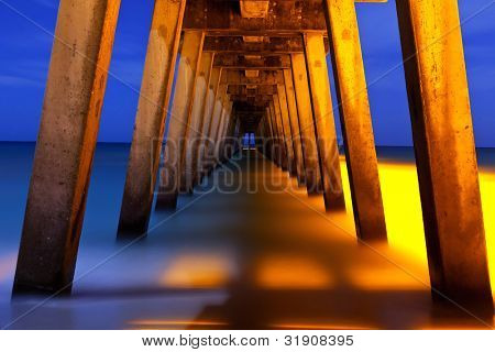 underside of pier at night, long time exposure
