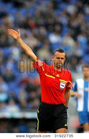 BARCELONA - APRIL, 7: Referee Muniz Fernandez during a Spanish League match between RCD Espanyol vs Real Sociedad at the Estadi Cornella on April 7, 2012 in Barcelona, Spain