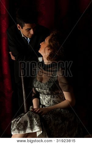 Elegant Couple Having Conversation