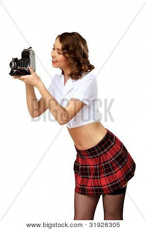 Young pretty woman dressed in retro style with camera