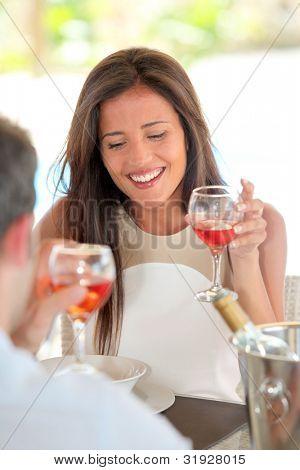 Portrait of attractive woman drinking wine in restaurant