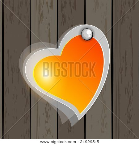Heart shape icon in yellow and orange colorhanging on wodden wall.EPS 10. Vector illustration.