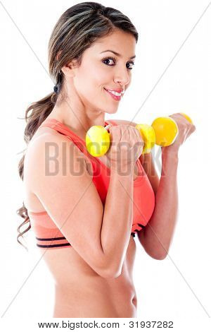 Atheltic woman holding free weights - isolated over a white background