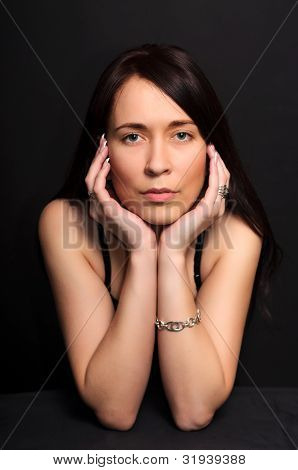Portrait Brunette  Woman On Black Background