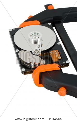 The Computer Hard Disk Clamped In A Manual Clamp