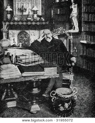 German writer Friedrich von Spielhagen in his office. Autotype by