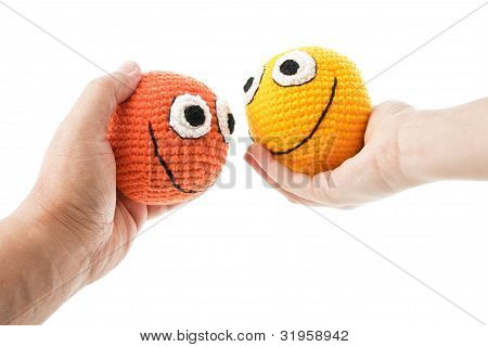 Two Smileys In Woman And Man Hands