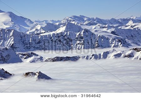 Peaks Above Clouds, Winter In The Austrian Alps