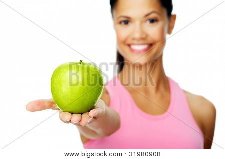 happy smiling woman showing healthy eating habits with a green apple