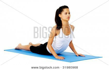 Healthy latino yoga woman does cobra yoga pose. This is part of a series of various yoga poses by this model, isolated on white