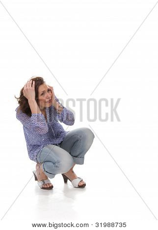 Scared woman holding her head