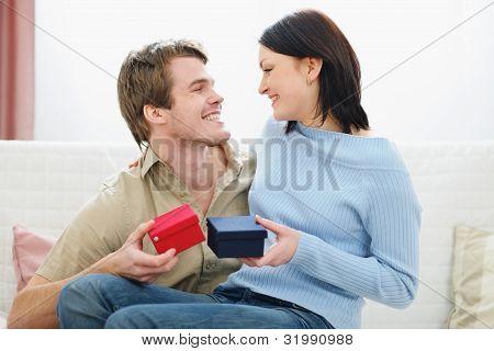 Romantic Couple Exchanging Presents
