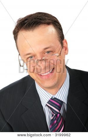 Smiling Businessman In Glasses