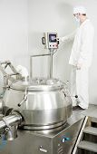 pharmaceutical factory worker at pharmacy industry manufacture with mixer granulator